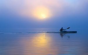 Kayak lone paddler photo