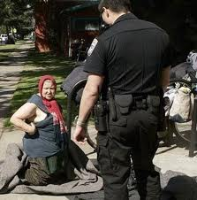 photo of homeless woman and police