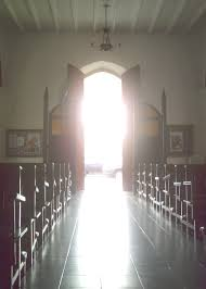 photo of church aisle with open doors