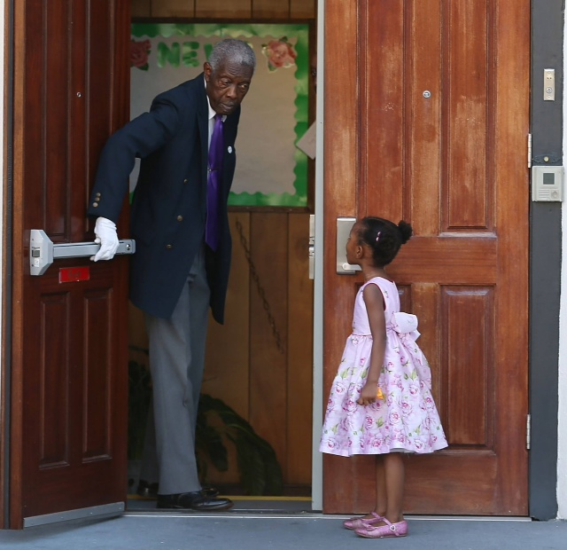An elderly African-American usher welcomed a little black girl to worship. He wanted her and all of us to know that love always win. & Mother Emanuel\u0027s Open Door \u2013 Green Preacher