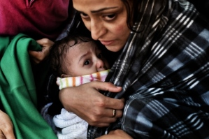 Refugee woman with baby